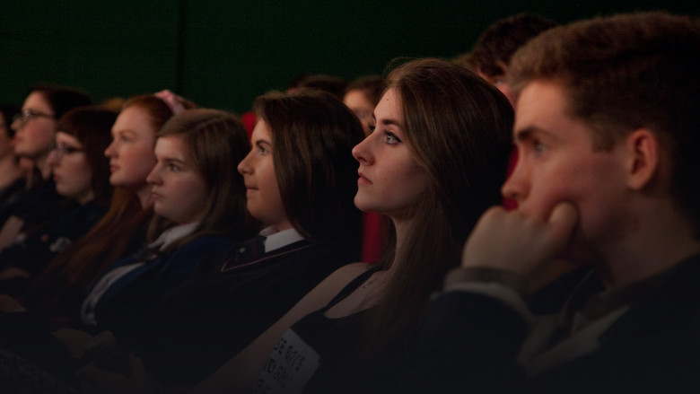 Young people watching film in cinema