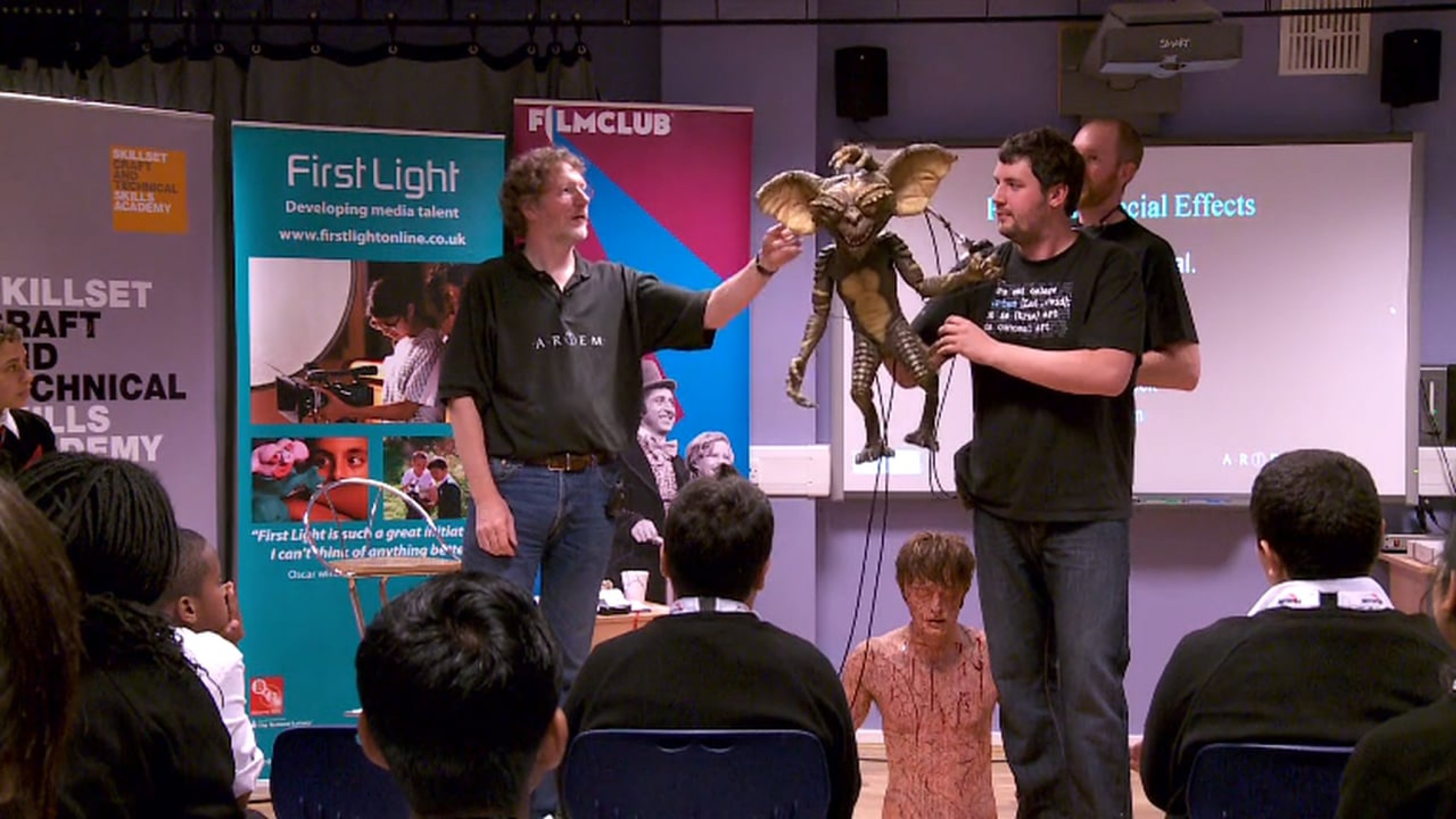 Mike Kelt of special effects company Artem Wounds talks to students at Acto