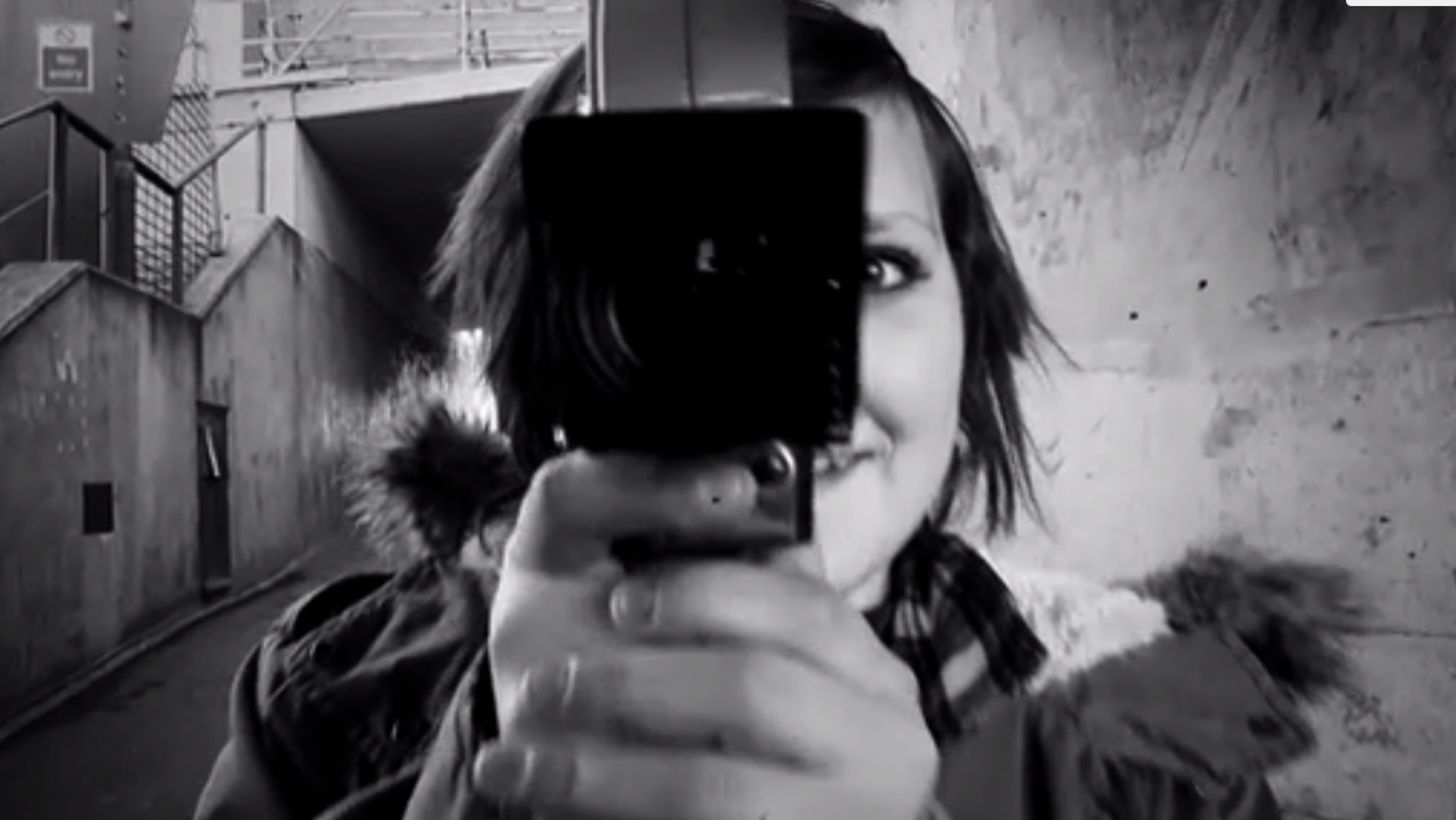 Black and white image of girl with a cinecamera.