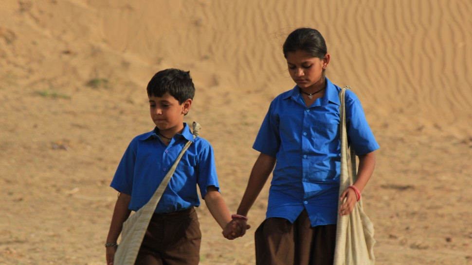 This image from Dhanak shows the characters holding hands in uniform.