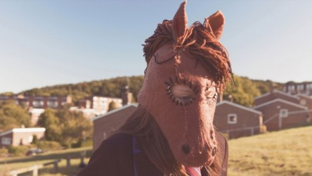 This image from Trigga shows the main character wearing her horse mask.