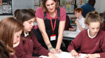 Lydia Fry, Art Director, with students at Calthorpe Park School