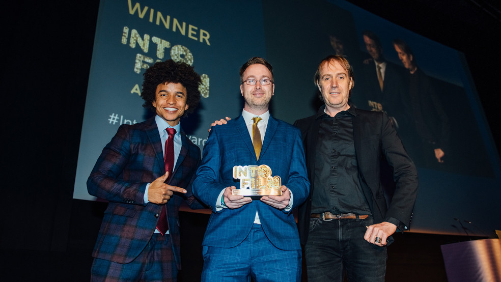 Teacher of the Year winner Rhys Roberts with host Radzi & actor Rhys Ifans