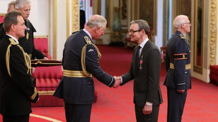 Into Film CEO, Paul Reeve receiving his MBE from Prince Charles