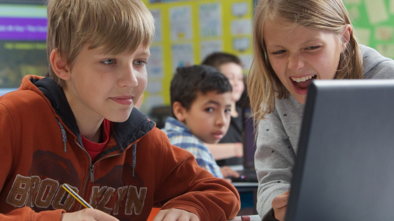 Children using laptop image (Anson Primary)