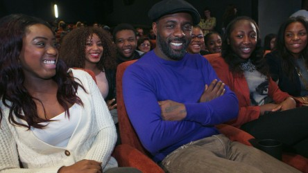 Idris Elba in cinema with young people