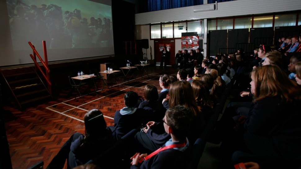 Group of children watching films in a sports hall