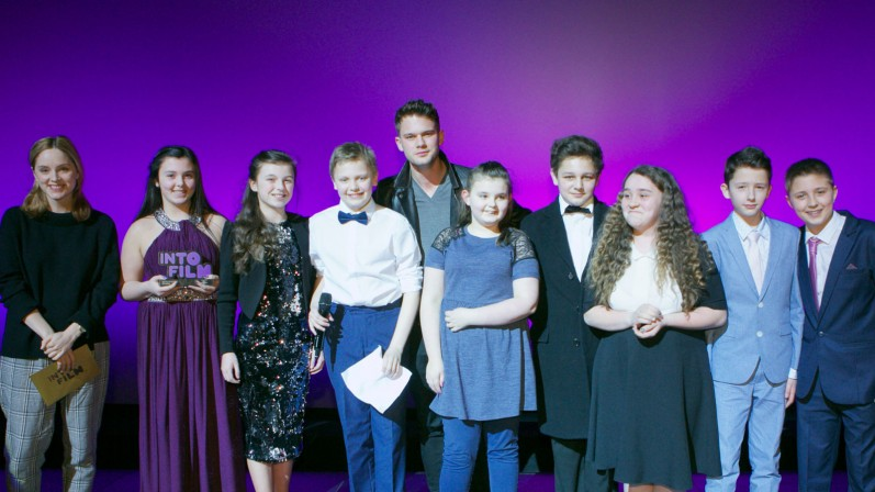 Jeremy Irvine and young people at the Into Film Awards