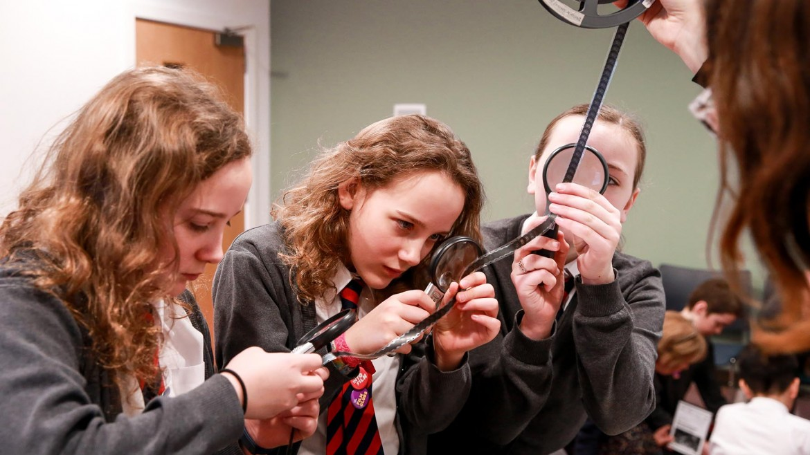 Pupils exploring archive film at Moving Image Archive Scotland