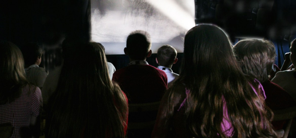 Young people watching old film in a club