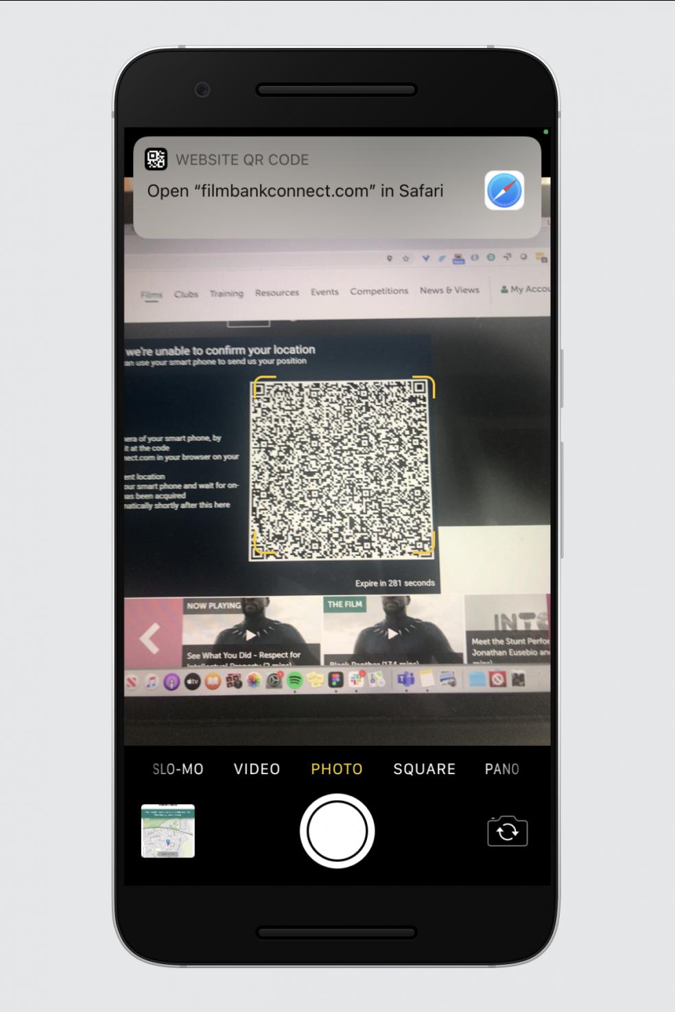 A phone camera pointed at a QR code
