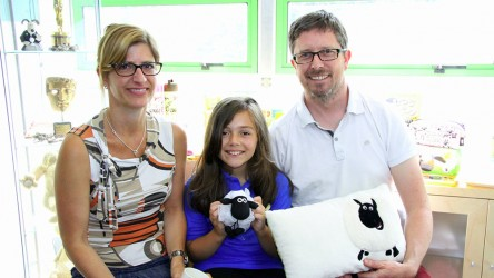 Jess with Shaun the Sheep producers holding Shaun
